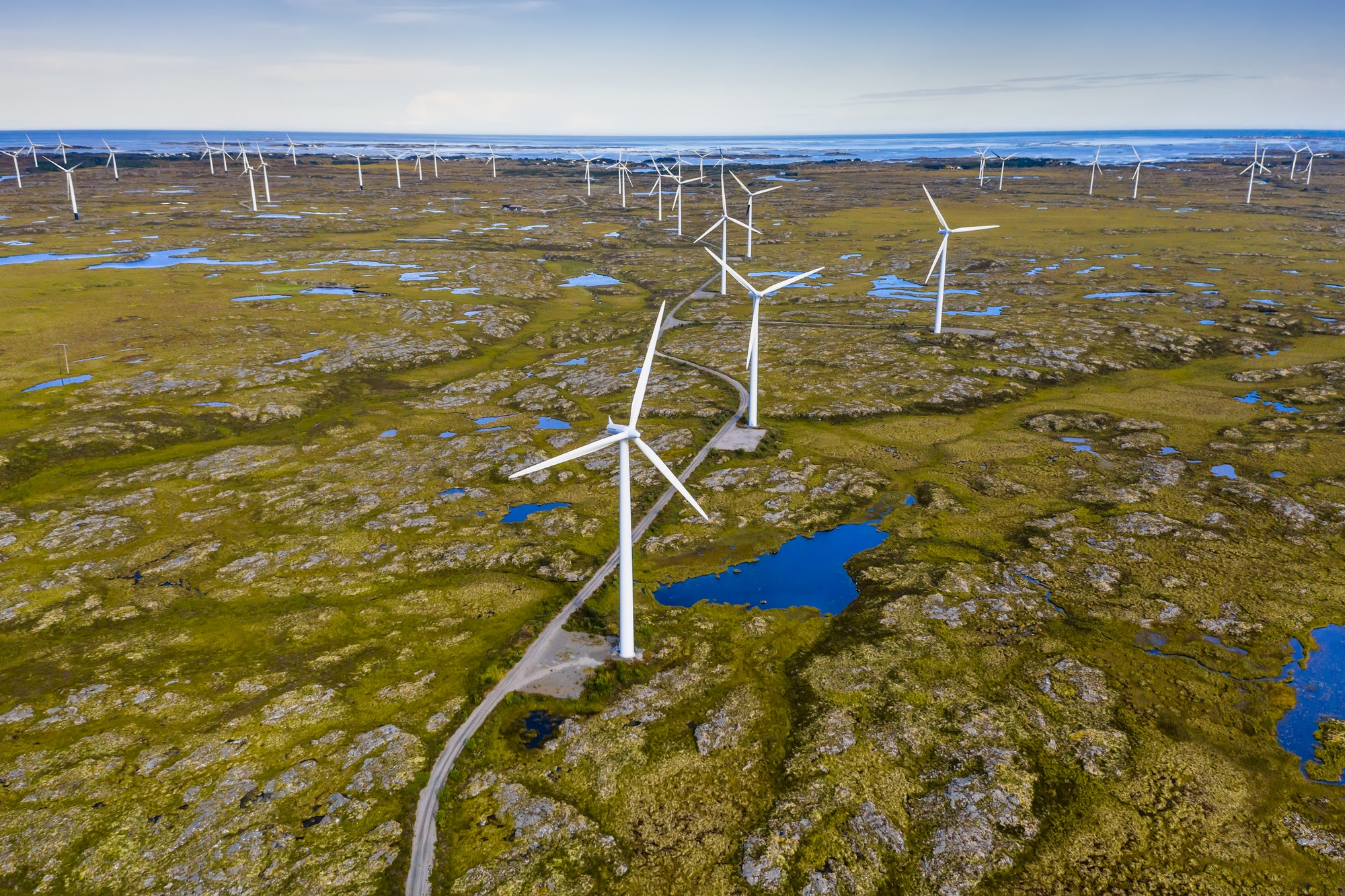 Wind generators in the arctic tundra. Norway, the island of Smola. Aerial view